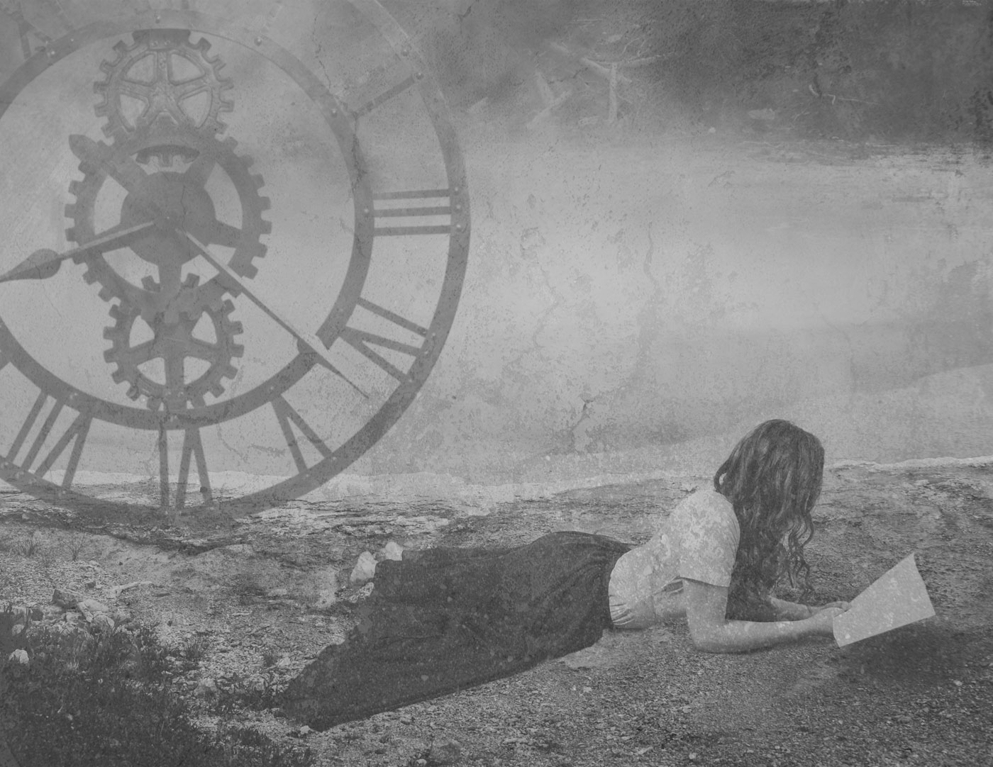 A woman in a dress lies reading on a foggy beach, her hair falling down to hide her face. An enormous mechanical clock hangs in the air.