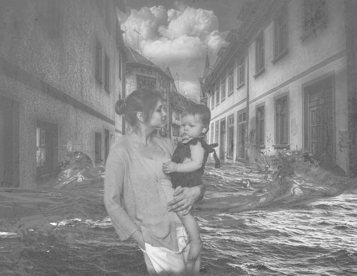 A woman holding a young child is superimposed on a scene of a flooded street.