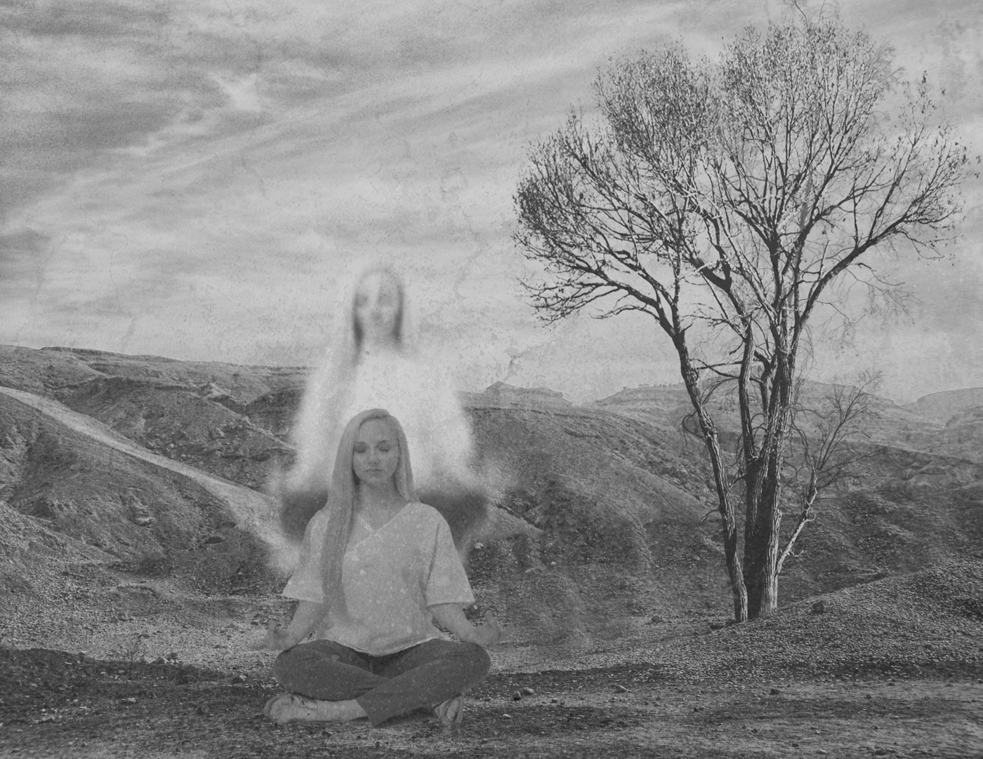 A girl sits cross-legged at the edge of a sandy ravine beside a single tree; her spirit appears to rise from her body.